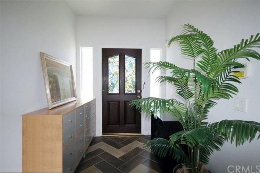 Front door entrance with marble tile flooring