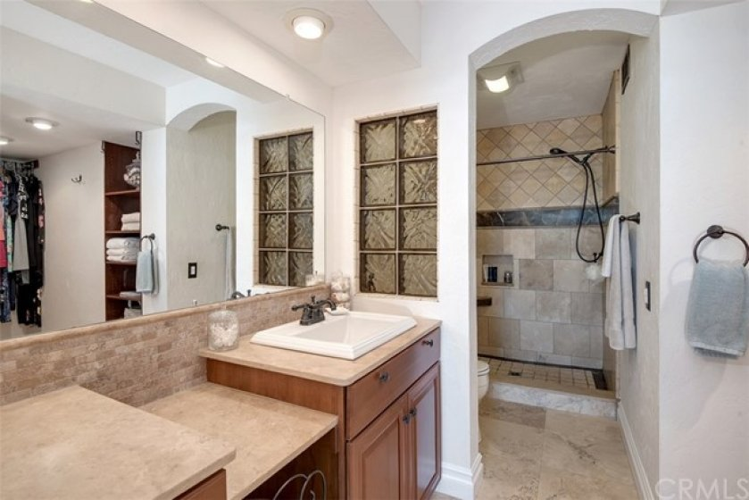 Completely remodeled, smart and functional bathroom with walk in shower. Gorgeous tile floors and shower walls.