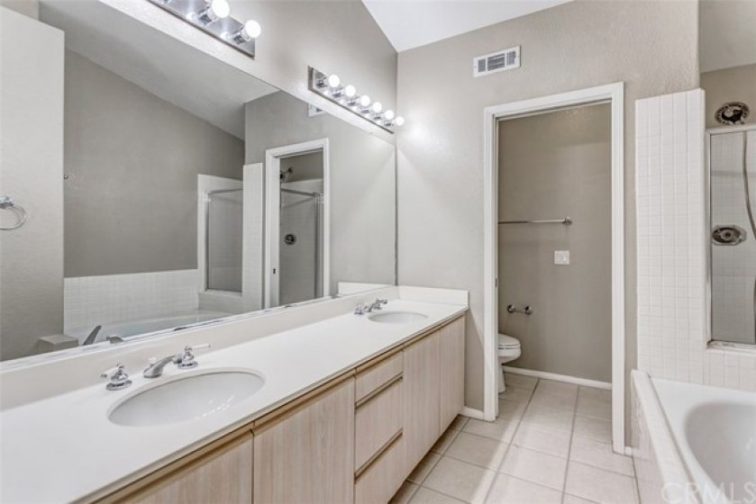The master bathroom has two sinks, a soaking tub, a walk in shower and a separate toilet room.