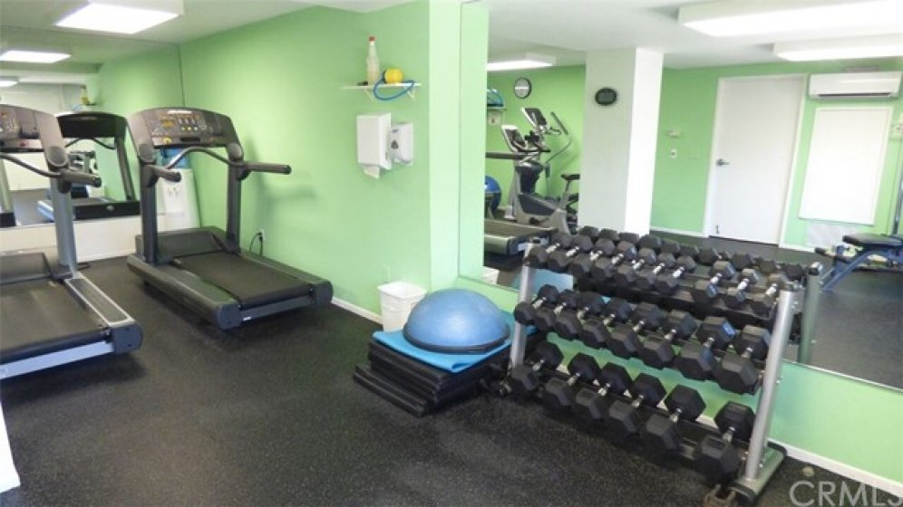 Association fitness room adjacent to pool