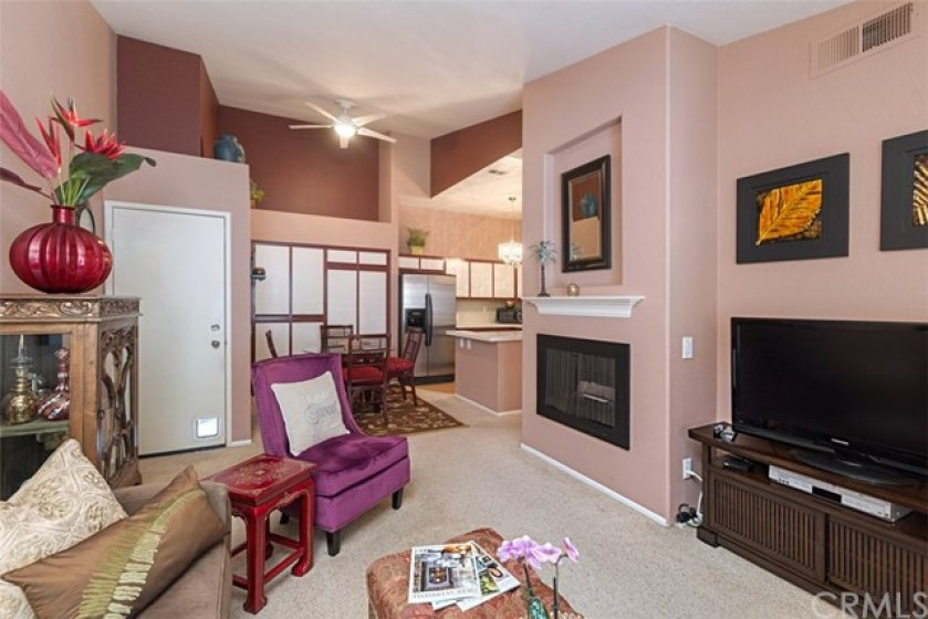 All your living area is located on one level, and features this nice, open floor plan, vaulted ceilings, ceiling fan and architectural nooks with two-tone custom paint.