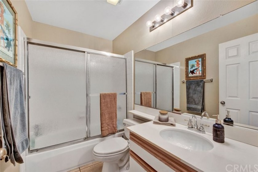 Guest bathroom with bathtub shower combo