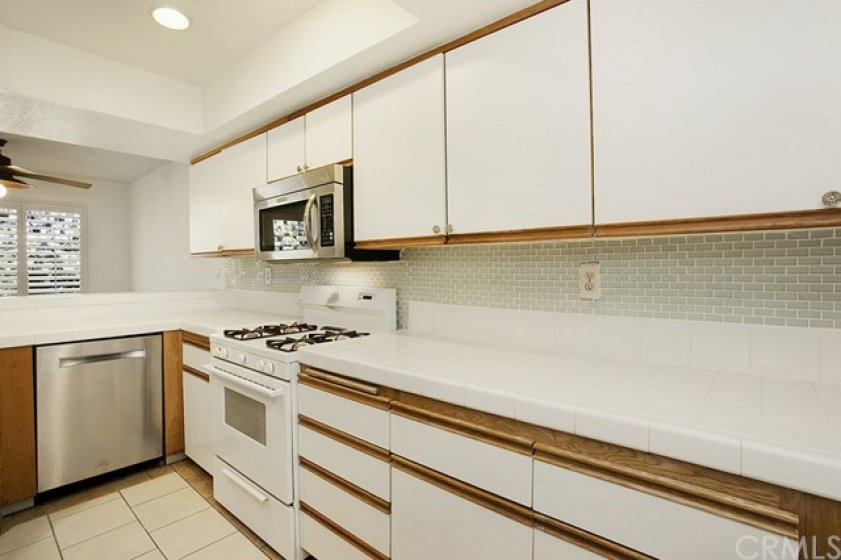 Open, well-equipped kitchen located off entry.