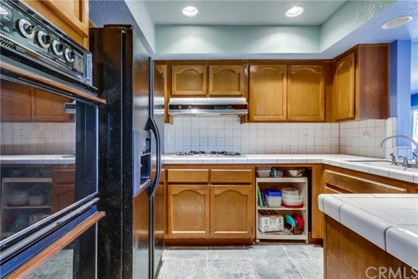 Prepare delicious meals in the kitchen offering ample storage/counter space, breakfast bar, and adjacent dining area