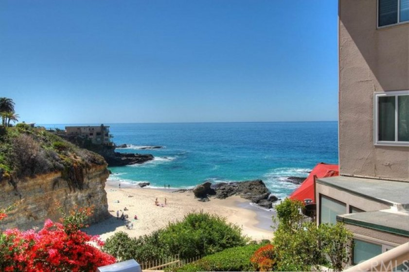 View of ocean, bluffs, beach, and rock outcroppings from this condo's oversized private deck.