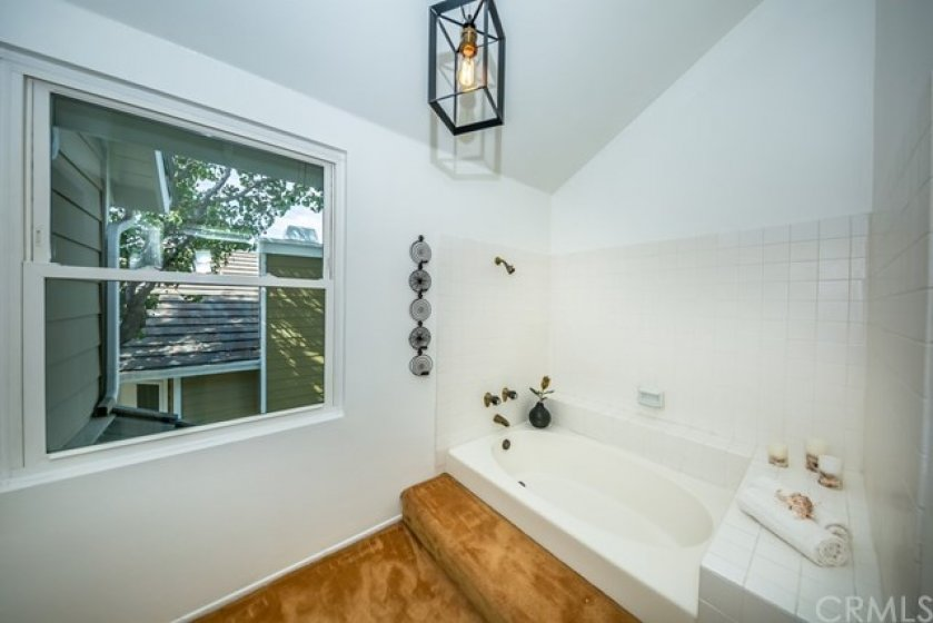Master bathroom with deep tub and shower.