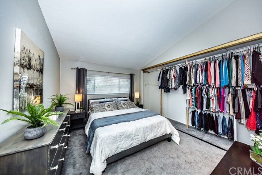 Master bedroom has a large closet with 2 tiers of hanging space which makes perfect for sharing closet space!