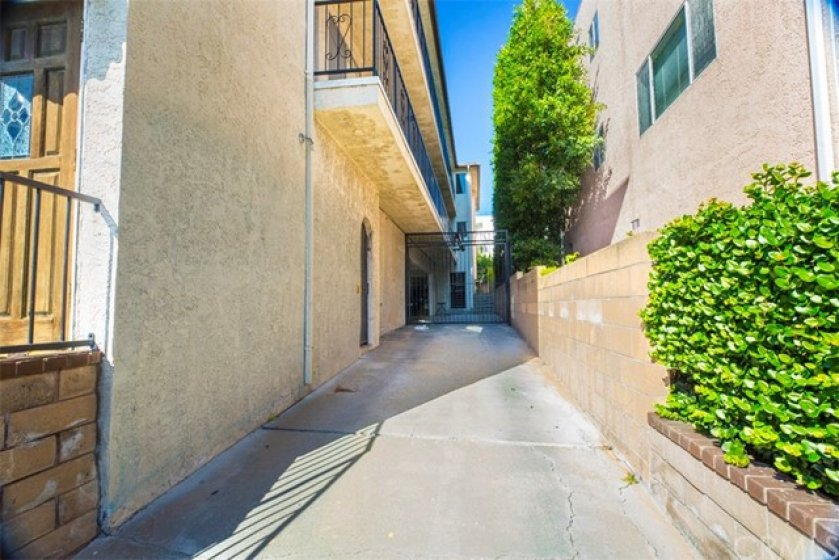 Driveway into complex garages from 9th Street. 1 parking space provided.