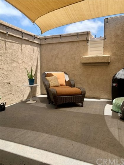This oversized patio with sail cloth covers is an ideal sanctuary, outside yet private.