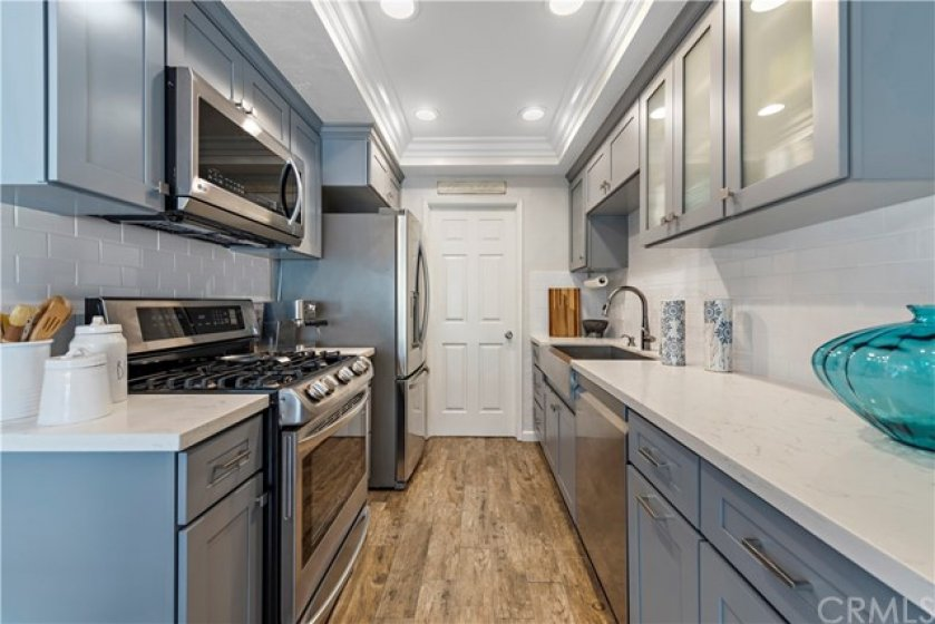 Custom kitchen with stainless steel appliances and sink.  Full extension pull out drawers, soft close cabinets and quartz countertops.