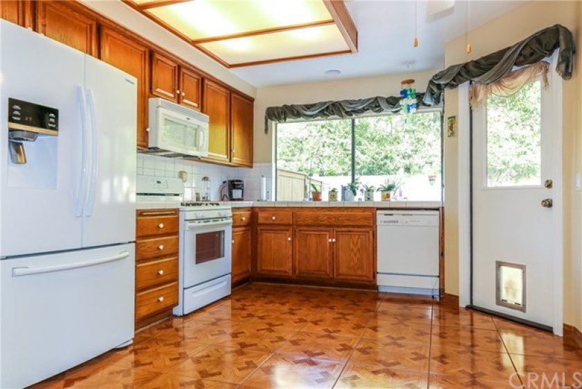 Very Well Kept Kitchen with Breakfast Nook and Door to the Patio