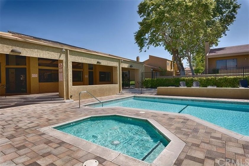 The main pool area is just around the corner and includes a clubhouse with full kitchen that can be used for parties, a large pool, a wading pool and a spa.