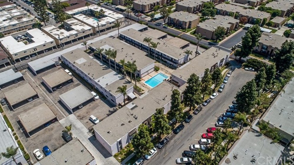 Condo complex is at the end of a cul-de-sac. Street parking available as well as a covered parking spot! No need to drive around looking for parking.