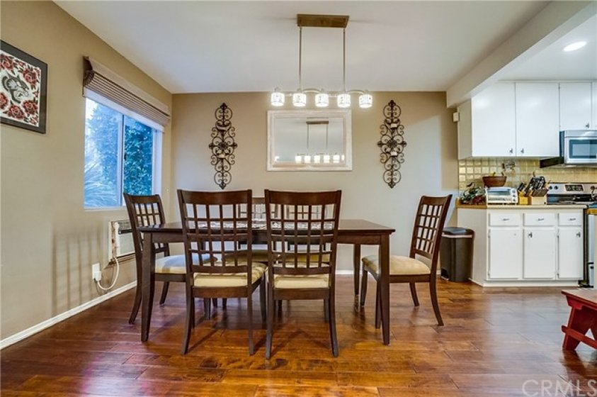 Light, bright Dining Area adjoining Living Room and Kitchen.  Great for entertaining.