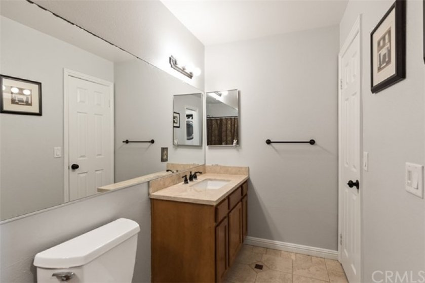 Very spacious bathroom with 2 sinks & granite counters.