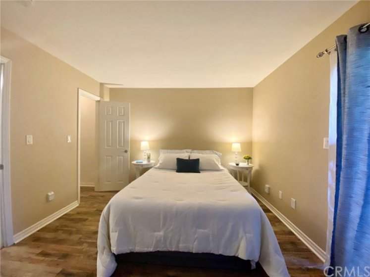 Master.  Queen Size Bed with two nightstands.  Room for a dresser at the wall at the foot of the bed