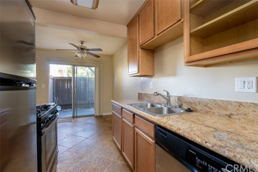 Beautiful galley kitchen with granite countertops, dishwasher, refrigerator included, gas stove and mircrowave