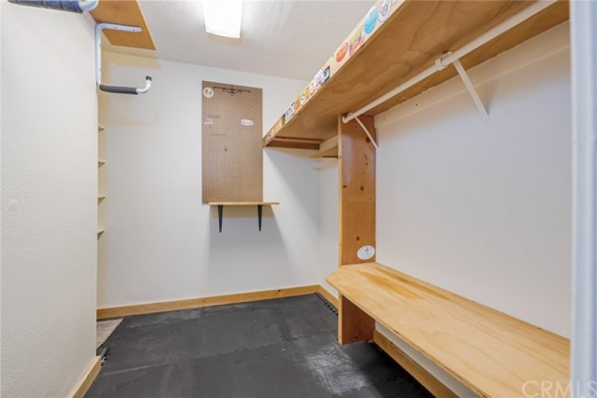 Utility closet can be used for bikes, surf boards, an office etc.