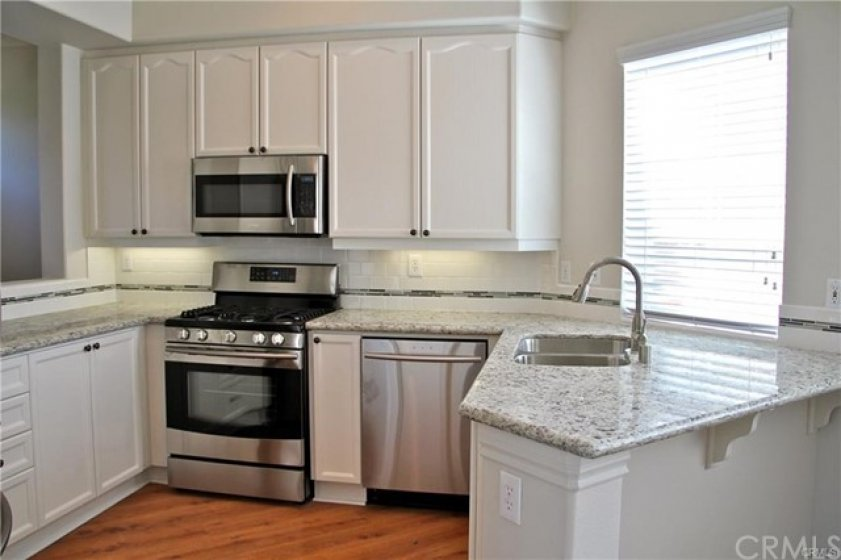 Granite counters & Stainless steel appliances/sink