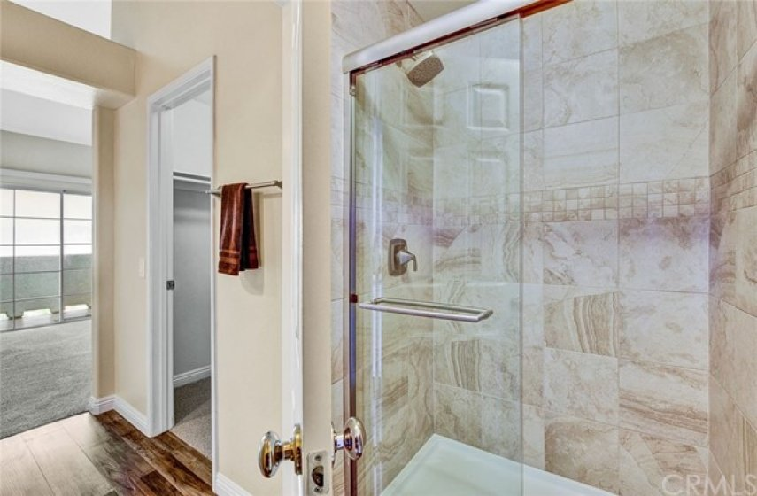 Remodeled walk-in master bathroom shower which is separate from vanity area