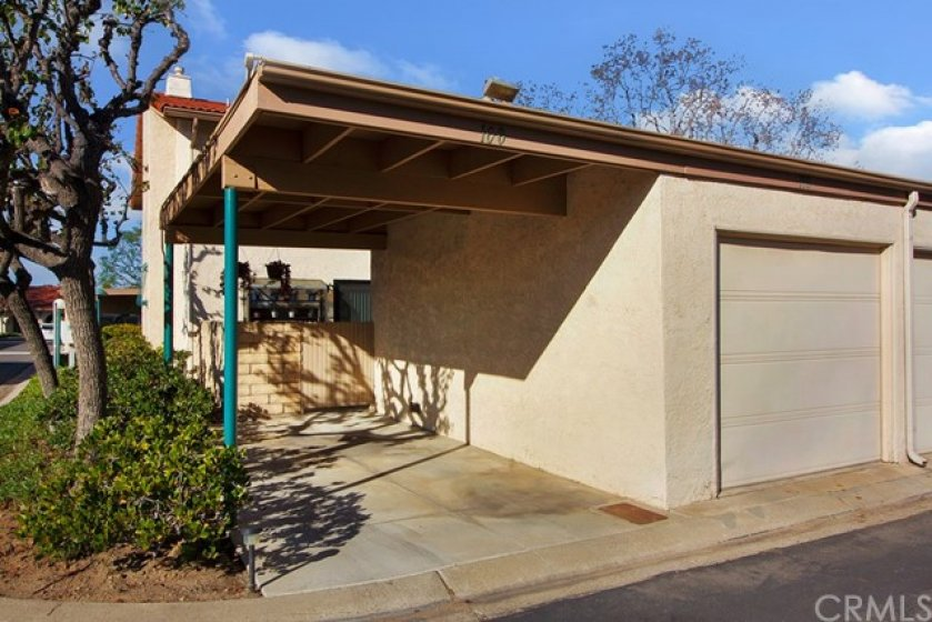 Private carport + single car garage with direct access to patio.