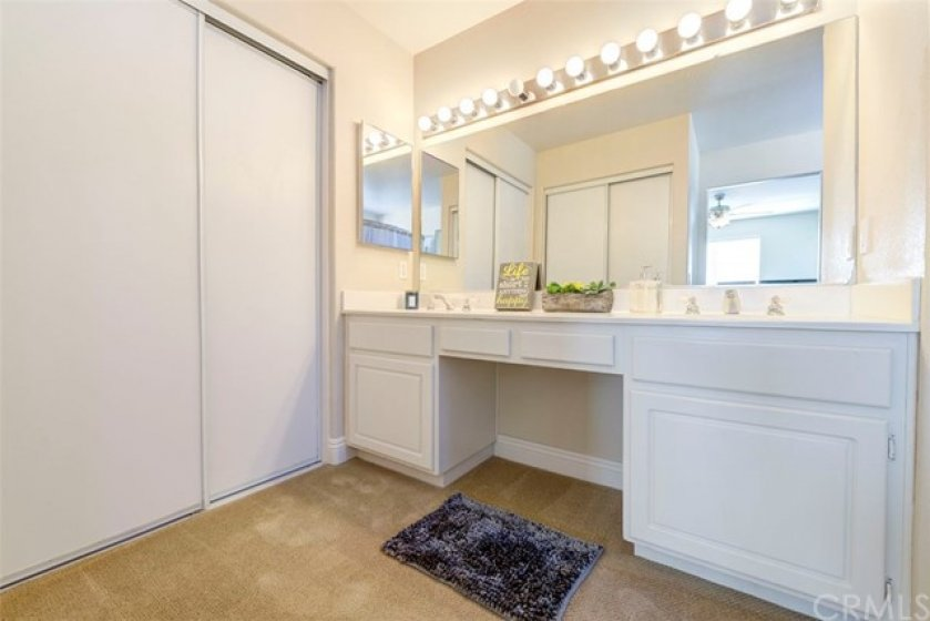 Master en suite featuring 2 closets and a dual vanity.