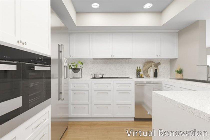 """""""Virtual renovation"""" prepare delicious meals in the kitchen offering ample storage/counter space, breakfast bar, and adjacent dining area"""