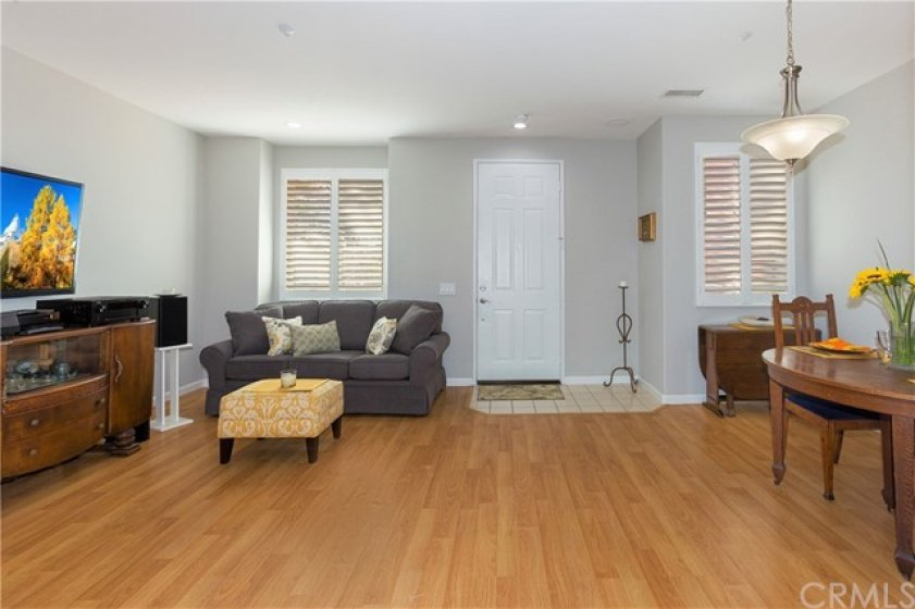 Large living room - roomy and includes everyone - pass through from kitchen to dining room, so is nice and open on first floor - Continuous flooring throughout first floor with lovely newer plantation shutters and designer paint palette, brushed nickel fixtures - all of which show care has been taken in this home!