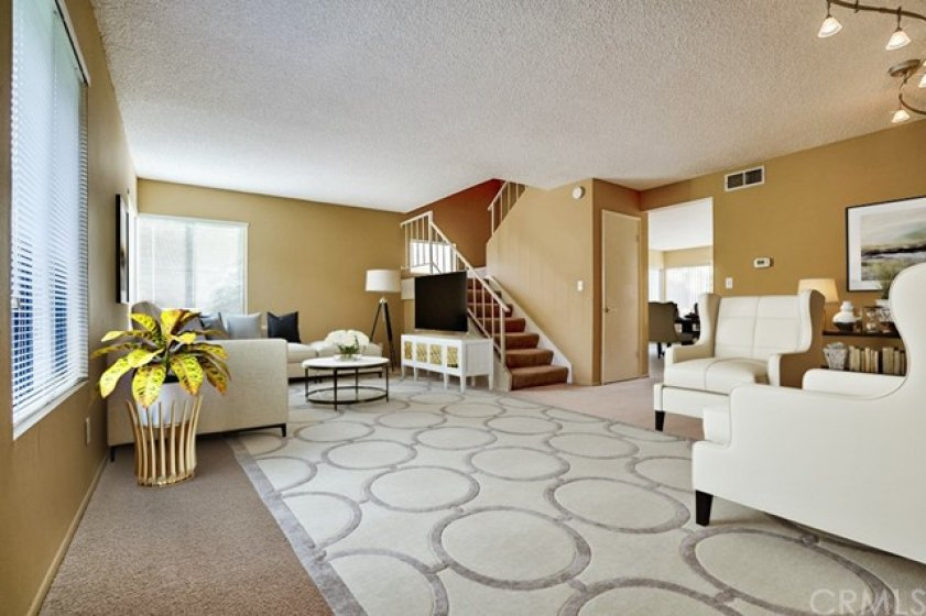 Spacious sunlit living area (virtually staged)