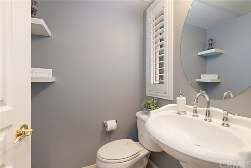 Guest Bathroom with Plantation Shutters, Pedestal sink and decorative shelving ~