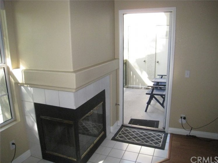 There is a door leading from the living room to the balcony. The balcony also features a storage closet.
