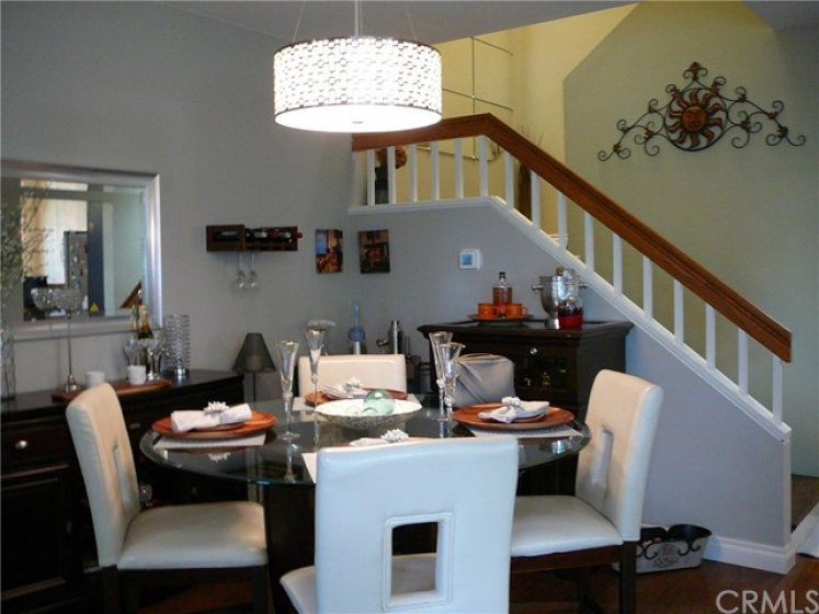 Open dining room with updated hanging dining room light fixture.