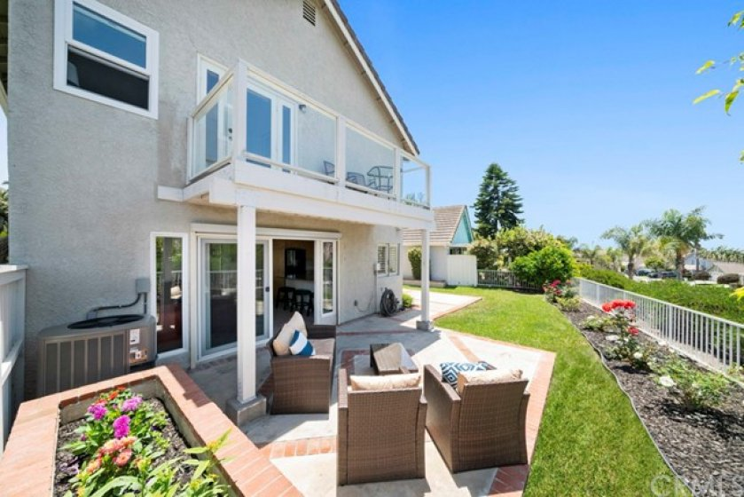 Extra wide sliding glass door from family room leads to outdoor patio with sit down peek-a-boo ocean views.