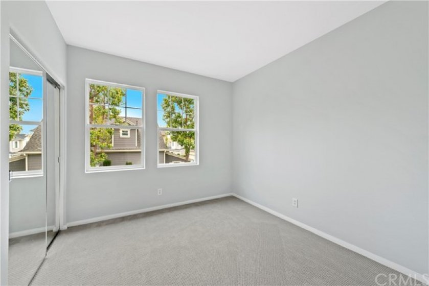 Upstairs bedroom with new upgraded carpet. Dual windows increases the natural light. Boasts large mirrored closet doors.