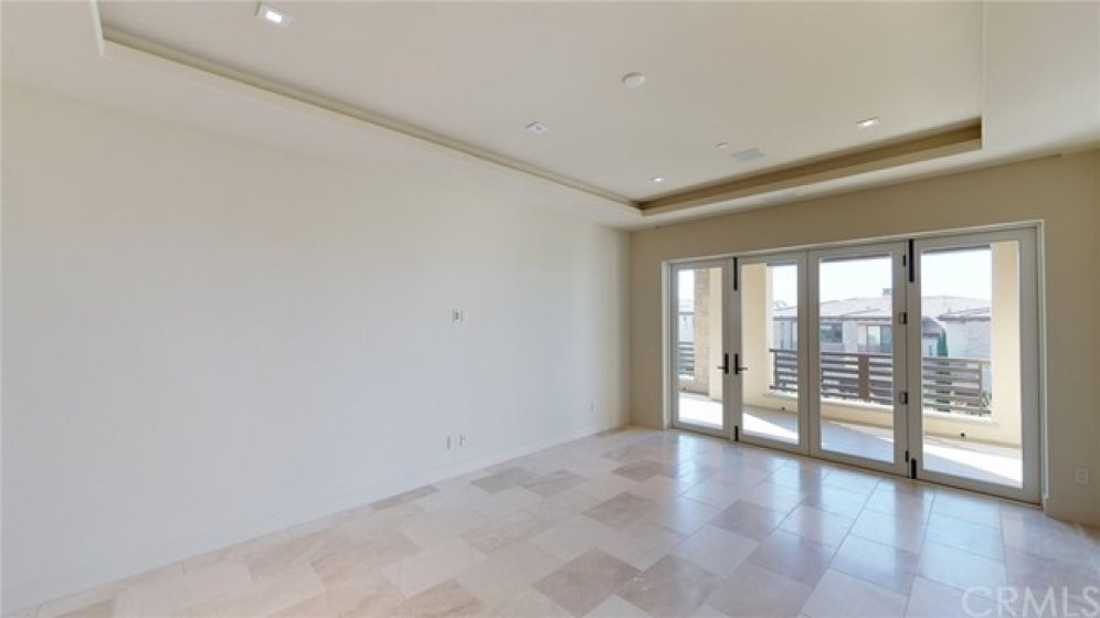 Master bedroom with stacking doors and terraced balcony.