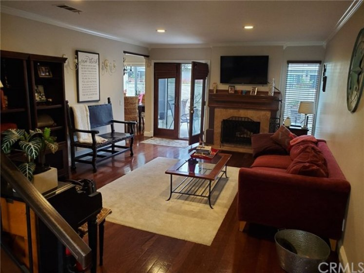 LARGE OPEN LIVING ROOM SUPER LIGHT AND BRIGHT OPENS TO OVERSIZED PATIO PERFECT FOR ENTERTAINING. SEPARATE ACCESS OFF PATIO TO GREENBELTS AND TRAILS