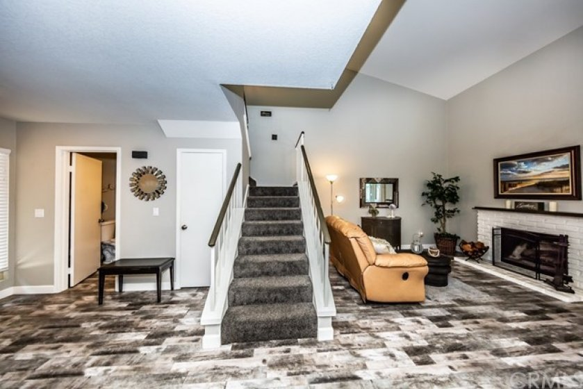 Taking the stairs up to the second story will lead you to the 3 bedrooms and 2 bathrooms.
