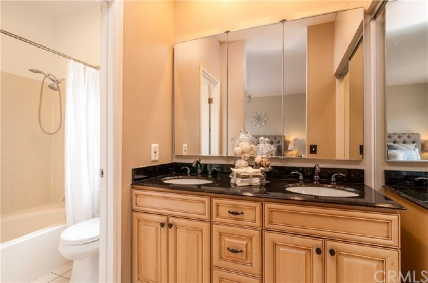 Master bath with dual his and her sinks, tub/shower combo and walk in closet