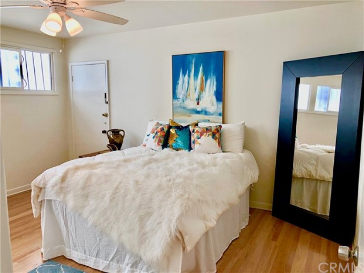 Massive bedroom, with access to back alley (great for guests in wheelchairs, or those who can't clime the stairs out front well)