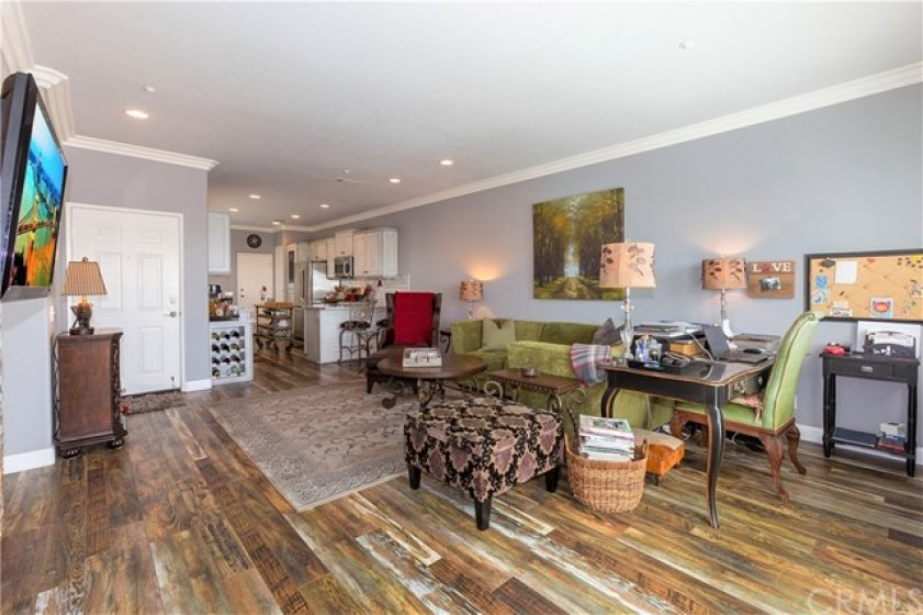 Lives large - owner uses space for living room and office-uses counter breakfast bar and eat-in kitchen for dining - can be living room and dining room with office upstairs...you decide!