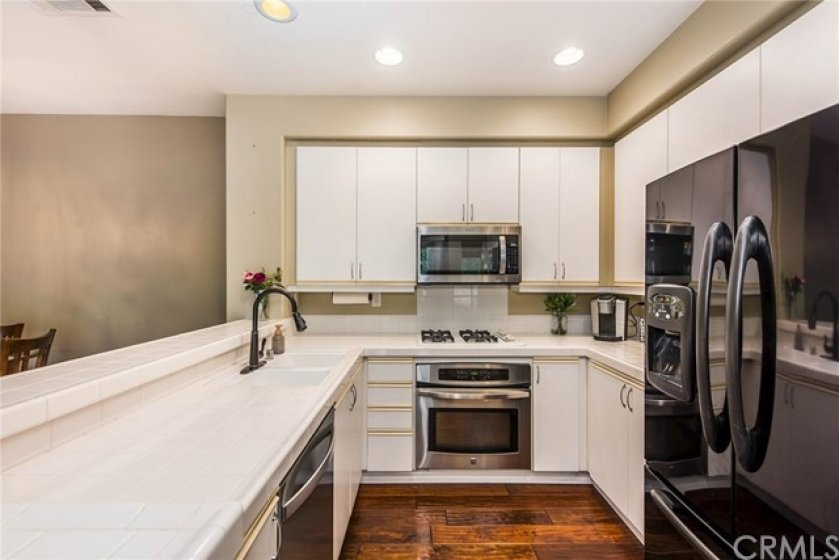 Beautiful stainless steel appliances and loads of kitchen storage