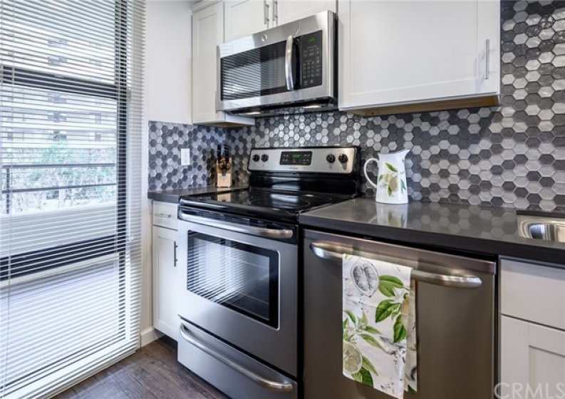 Bright and open kitchen with stainless steel appliances
