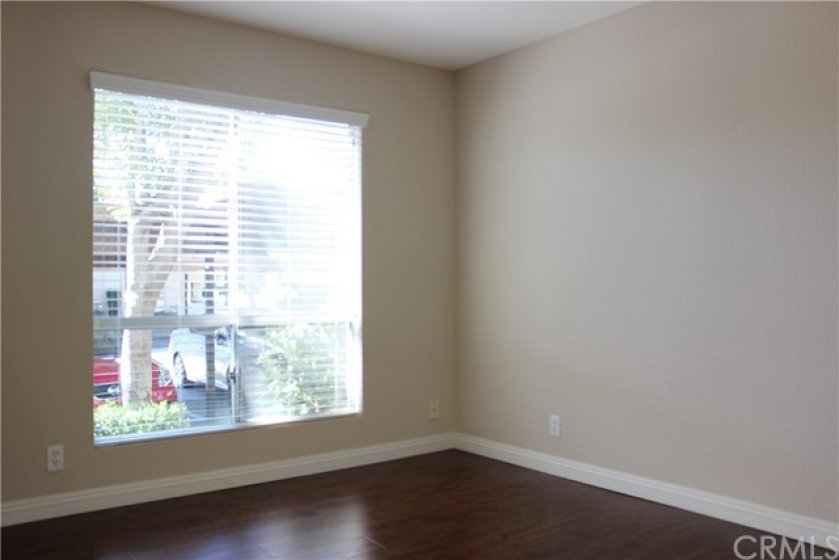 The bedroom is spacious with New flooring, new baseboards and large window for lots of natural light.