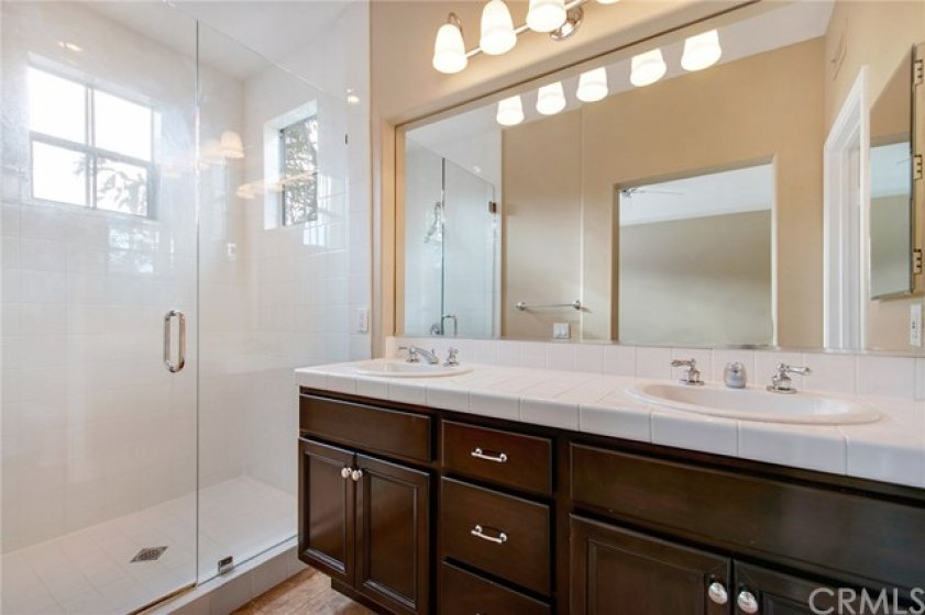 Master bath with huge shower enclosure and convenience of dual sinks and plenty of counter space.