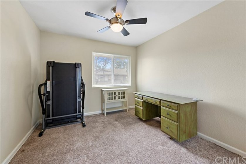 Third bedroom also boast upgraded plush carpeting, a ceiling fan and mirrored closet door.