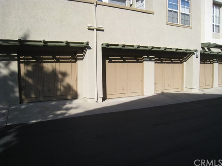 The garage (shaded) is a short walk away and also features a rear exit door!