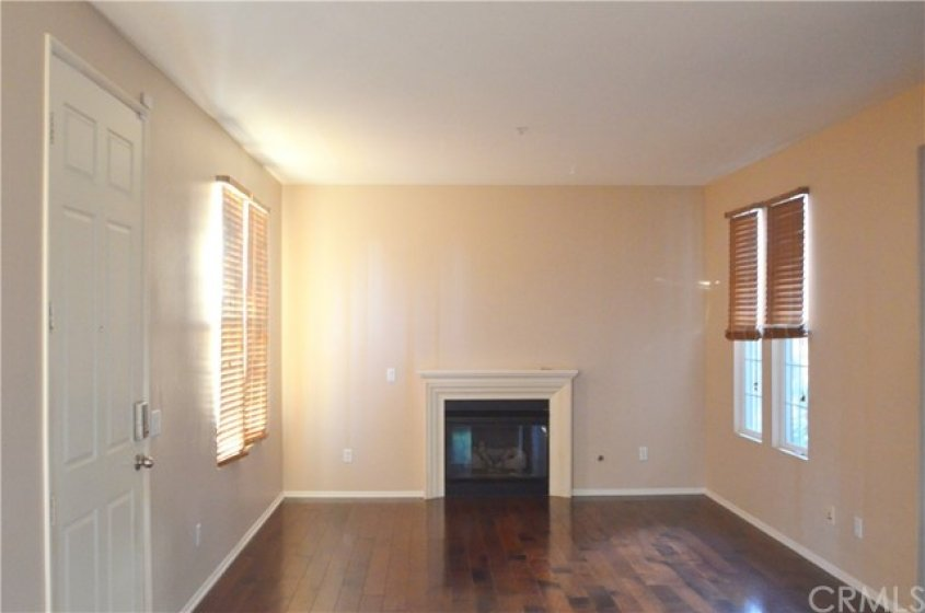 """""""Great Room"""" consisting of Living Room with cozy fireplace and Formal Dining."""
