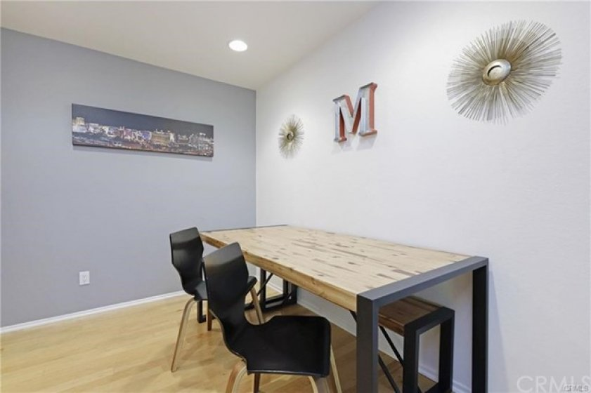 Raised dining area with recessed lighting. Spacious enough for almost any shape of table.