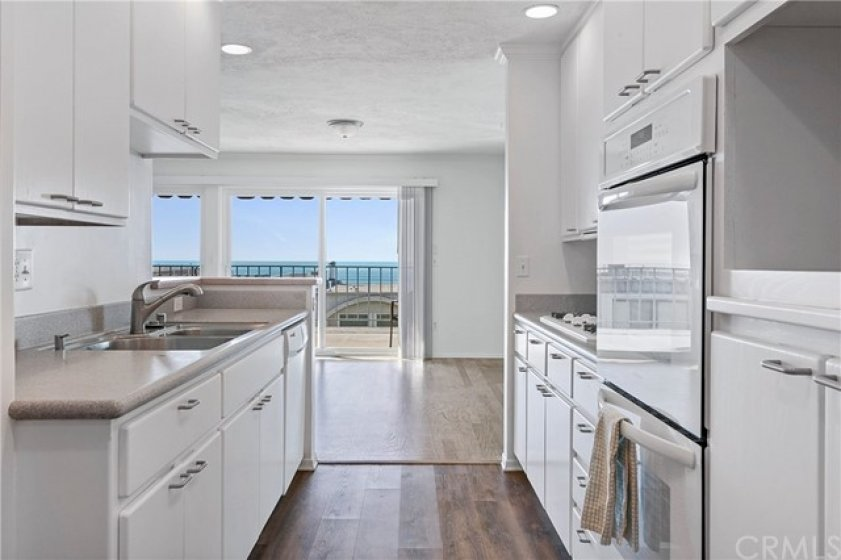 Galley style kitchen has lots of storage cabinets