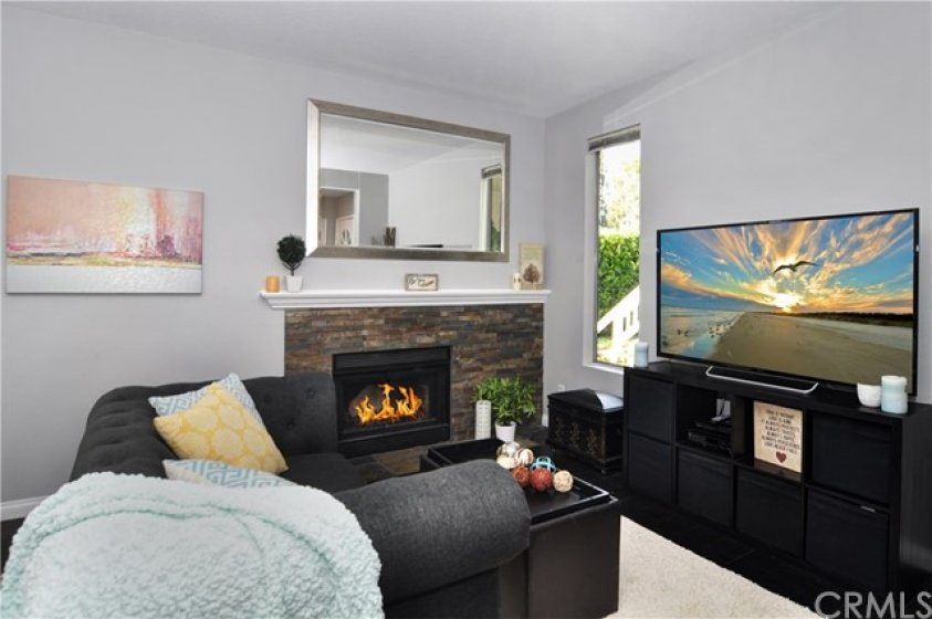 The custom stacked stone fireplace provides a cozy feel to the living room.